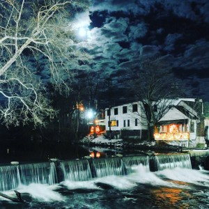 The former Mario's Salon building sits on the side of the upper falls in Chagrin Falls, OH.